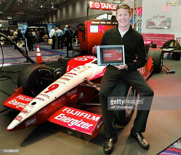 Indy car driver Scott Dixon winner of the 2003 Indy Racing League Championship holds a Tablet PC at COMDEX in Las Vegas November 17 2003 The Target...