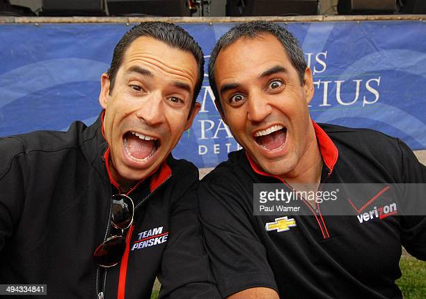 Indy Car series Team Penske drivers Helio Castroneves and Juan Pablo Montoya attend the Grand Prix Street Fest at Campus Martius Park on May 28 2014...