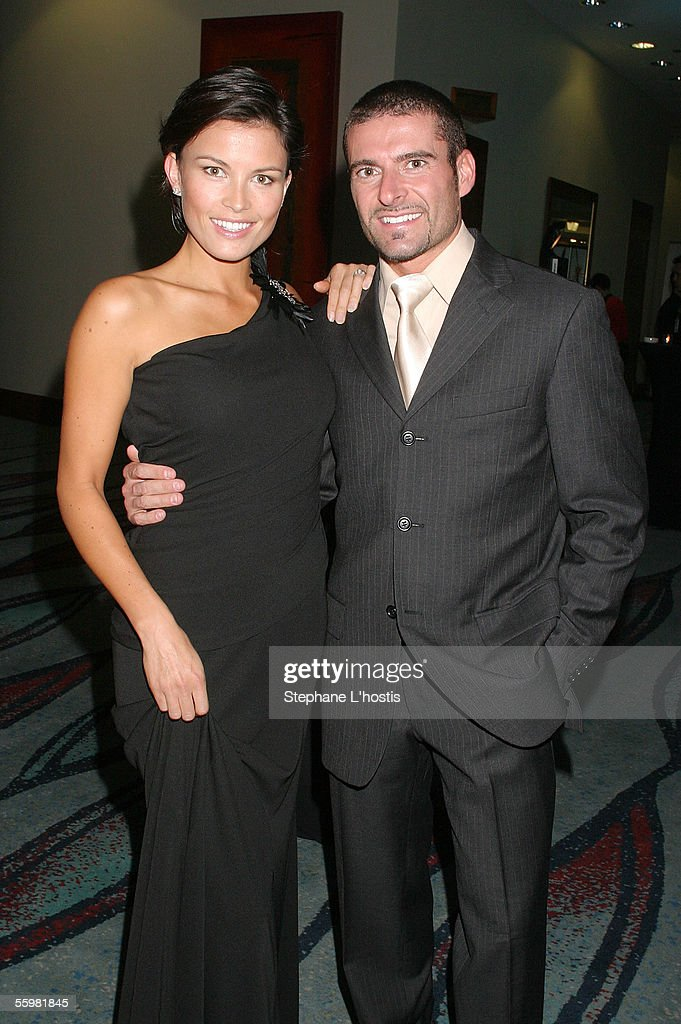 Indy Driver Alex Tagliani and his wife Bronte attend the Lexmark Indy 300 Gala Ball presented by Simex Tyres at the Jupiters Casino, October 21, 2005 on the Gold Coast, Australia.