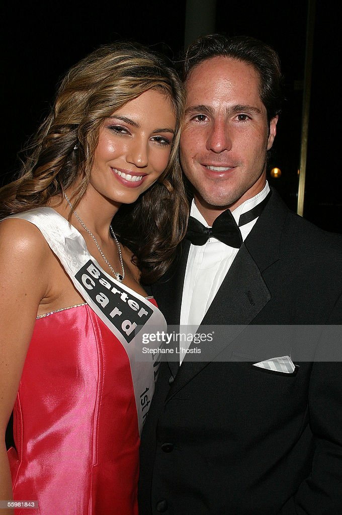 Indy Driver Mario Dominguez poses with Miss Indy Runner-up 2005 Lisa-Shae Buttler at the Lexmark Indy 300 Gala Ball presented by Simex Tyres at the Jupiters Casino, October 21, 2005 on the Gold Coast, Australia.