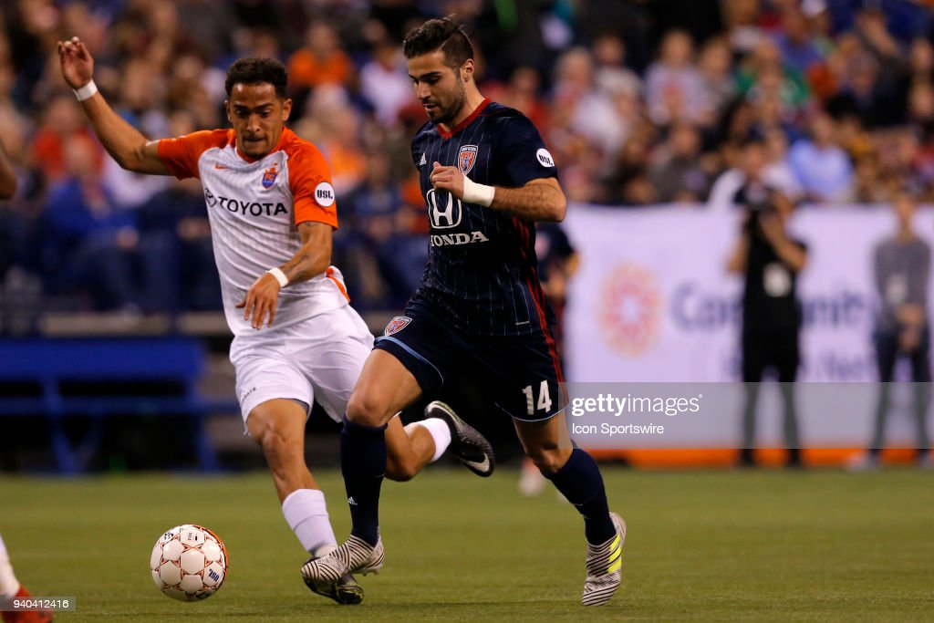 Indy Eleven forward Soony Saad (14) drives the ball up field past FC Cincinnati mid fielder Will Seymore (8) during the USL Soccer match between FC Cincinnati an Indy Eleven on March 31, 2018, at Lucas Oil Stadium in Indianapolis IN. FC Cincinnati defeated the Indy Eleven 1-0.