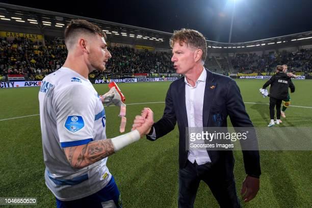Indy Groothuizen of ADO Den Haag coach Alfons Groenendijk of ADO Den Haag celebrates the victory during the Dutch Eredivisie match between ADO Den...