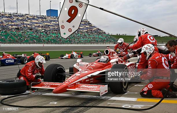 Indy Racing League driver Scott Dixon lost the lead during this pit stop for the Road Runner Turbo Indy 300 at Kansas Speedway in Kansas City Kansas...