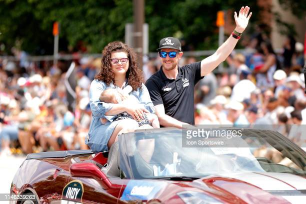 IndyCar driver Charlie Kimball of the Fiasp Carlin Chevrolet and his wife Kathleen holds daughter Hannah wave to the crowd during the 500 Festival...