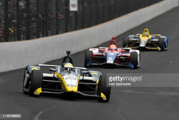 IndyCar driver Charlie Kimball of the Fiasp Carlin Chevrolet dives into turn one ahead of IndyCar driver Matheus Leist of the ABC Supply A.J. Foyt...