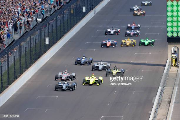 Indycar driver Ed Carpenter of Ed Carpenter Racing leads the field into turn one to start the Indianapolis 500 on May 27 at the Indianapolis Motor...