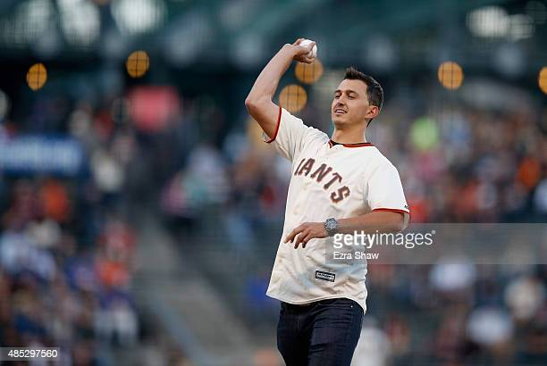 IndyCar driver Graham Rahal throws out the ceremonial first pitch before the San Francisco Giants game against the Chicago Cubs at ATT Park on August...
