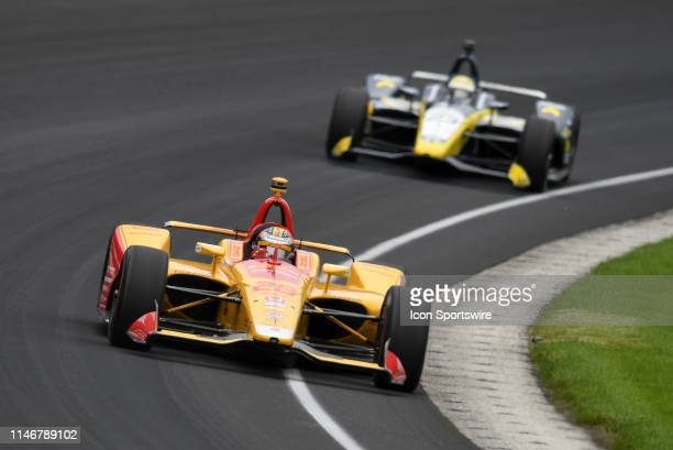 IndyCar driver Ryan Hunter-Reay of the DHL Andretti Autosport Honda drives through turn one ahead of IndyCar driver Charlie Kimball of the Fiasp...