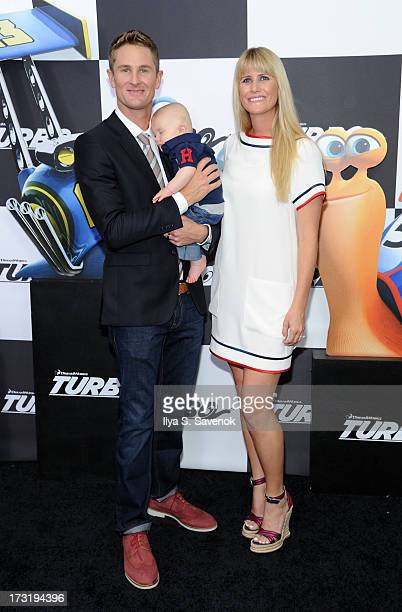 IndyCar Driver Ryan HunterReay with his son Ryden HunterReay and wife Beccy HunterReay attend the 'Turbo' New York Premiere at AMC Loews Lincoln...