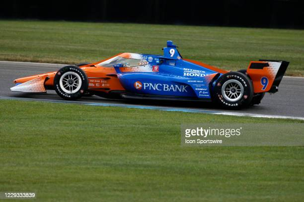 IndyCar driver Scott Dixon drives thru the second turn during the IndyCar Harvest GP Race 1 on October 2 at the Indianapolis Motor Speedway in...