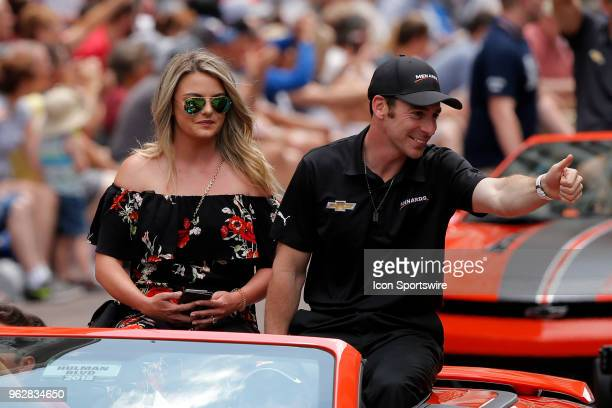 Indycar driver Simon Pagenaud of Team Penske and girlfriend Hailey McDermott wave to the crowd during the 500 Festival Parade on May 26 in...