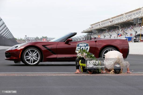 IndyCar driver Simon Pagenaud of the Menards Team Penske Chevrolet and his Fiancee Hailey McDermott kiss the bricks after winning the NTT IndyCar...