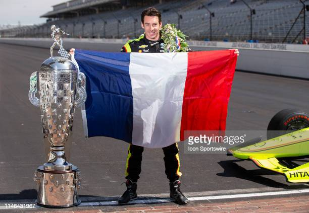 IndyCar driver Simon Pagenaud of the Menards Team Penske Chevrolet with the Borg-Warner Trophy and the French Flag during the Indianapolis 500...