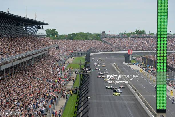 IndyCar driver Simon Pagenaud of the Menards Team Penske Chevrolet leads the field tot he green flag for the start of the NTT IndyCar Series 103rd...