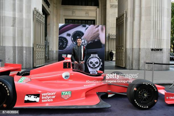IndyCar Series driver and TAG Heuer Corporate Ambassador Alexander Rossi poses with the Indy Show Car during the TAG Heuer Gran Turismo Event at Sony...