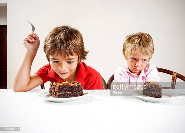 inequality concept, large slice small serving. - imbalance stock photos and pictures