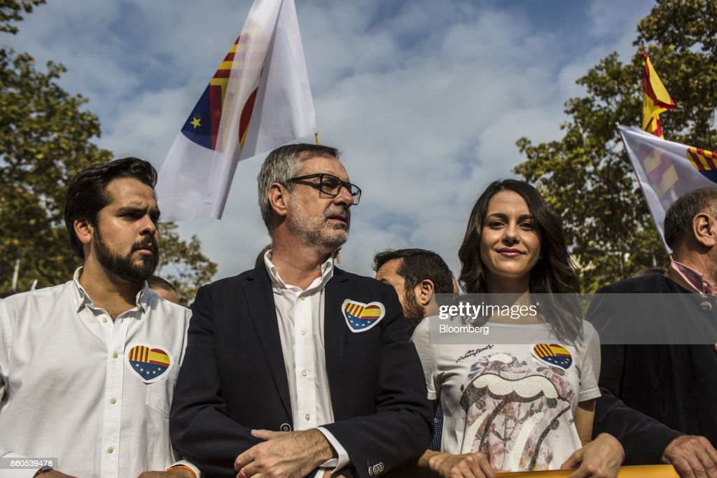 Ines Arrimadas, a Catalan parliament member, second right, stands with demonstrators in support of Spanish unity during a march on Spain's National Day in Barcelona, Spain, on Thursday, Oct. 12, 2017. Prime Minister Mariano Rajoy gave his Catalan antagonist Carles Puigdemont five days to clarify whether he has declared independence from Spain or not as the country prepared for its national holiday on Thursday. Photographer: Angel Garcia/Bloomberg via Getty Images