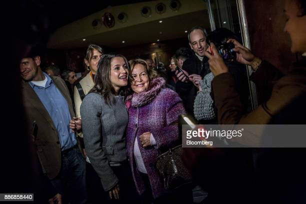Ines Arrimadas head of Ciudadadanos in the Catalan Parliament center left poses for a photograph with a supporter during an event to launch the...
