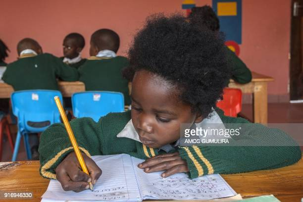Ines Billy a Grade One learner writes in her notebook at the Atsikana Pa Ulendo Girls Secondary Schools primary section on the outskirts of Lilongwe...