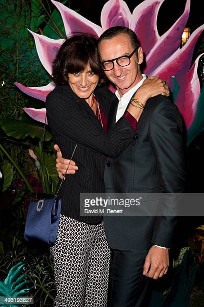 Ines de la Fressange and Bruno Frisoni arrive at Roger Vivier Summer Party at Loulou's on May 22 2014 in London England