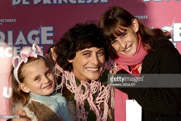 Ines de la Fressange and daughters Violette and Nina in MarnelaVallee France on October 16th 2004
