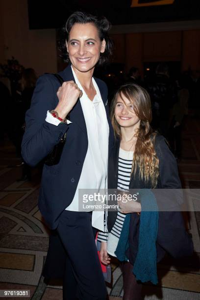 Ines De La Fressange and her daughter Nine attend the Yves Saint Laurent Exhibition at Le Petit Palais on March 10 2010 in Paris France
