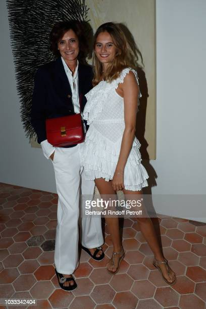 Ines de la Fressange and her daughter Violette d'Urso attend the Kering Heritage Days Opening Night at 40 Rue de Sevres on September 14 2018 in Paris...