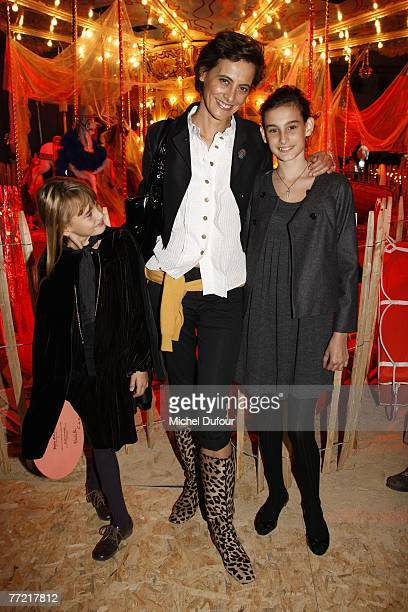Ines de la Fressange and her daughters attends the John Galliano fashion show during the Spring/Summer 2008 readytowear collection show at Stade...