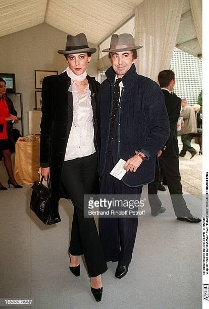 Ines De La Fressange and husband Luigi D'Urso at The Arc De Triomphe Grand Prix In Paris.