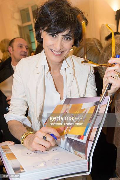 Ines de la Fressange signs the 'Roger Vivier' book as she attends the Roger Vivier Cocktail to celebrate the launch of the book 'Roger Vivier' as...
