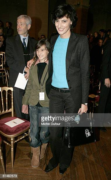 Ines de la Fressange with her daughter Nine attend the Yves Saint Laurent fashion show as part of Paris Fashion Week Spring/Summer 2005 on October 10...