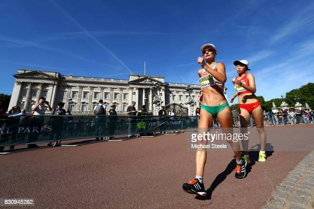 Ines Henriques of Portugal and Hang Yin of China walk in front of Buckingham Palace in the Women's 50km Race Walk final during day ten of the 16th...