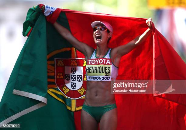 Ines Henriques of Portugal celebrates winning the Women's 50km Race Walk final in a new world record time during day ten of the 16th IAAF World...