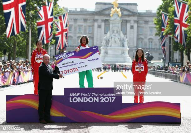 Ines Henriques of Portugal gold celebrates on the podium after setting a new world record of 40556 in the Women's 50 Kilometres Race Walk final...