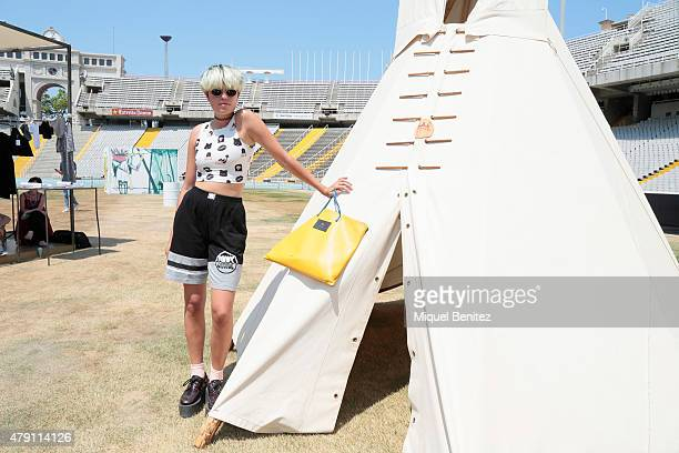Ines is seen wearing a O'mighty Weekend top Sunglasses from the Madrid's Rastro Cohice short 'Musa Bajo el Arbol' handbag and Underground shoes at...