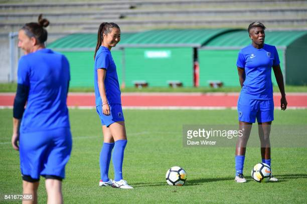 Ines Kore of Paris FC Ami Otaki of Paris FC and Celine Deville of Paris FC during a training session on September 1 2017 in Bondoufle France