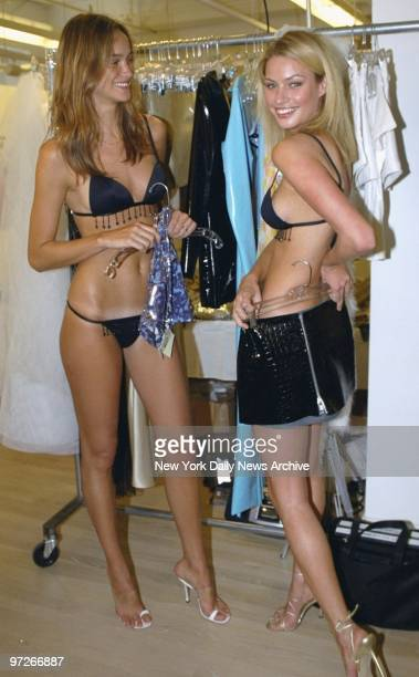 Ines Rivero and Kristy Hinze are dressed for success as the Victoria's Secret models prepare for a showing in Paris at the outfitt's New York studio