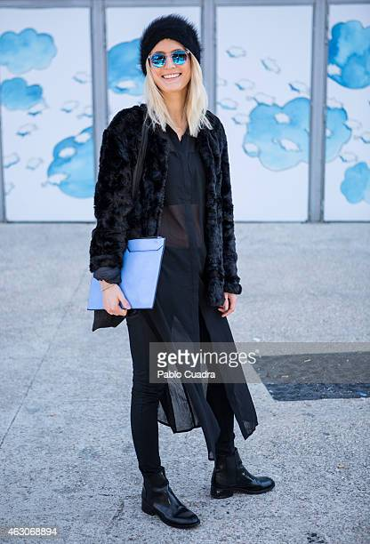 Ines wears Zara shoes Cos dress and cap and Mano coat during Mercedes Benz Madrid Fashion Week Fall/Winter 2015/16 at Ifema on February 8 2015 in...