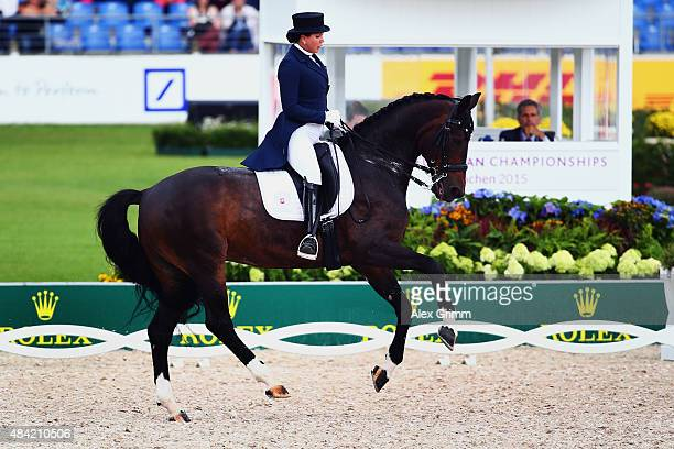 Inessa Merkulova of Russia performs on her horse Mister X during the Dressage Grand Prix Special Individual Final on Day 4 of the FEI European...