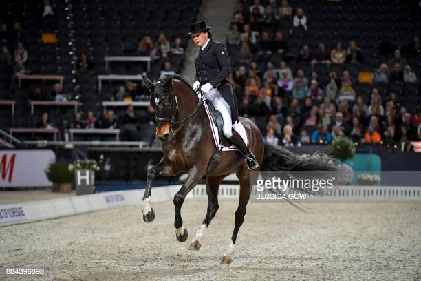 Inessa Merkulova of Russia rides her horse Mister X during the FEI Grand Prix dressage qualifying event at the Sweden International Horse Show on...