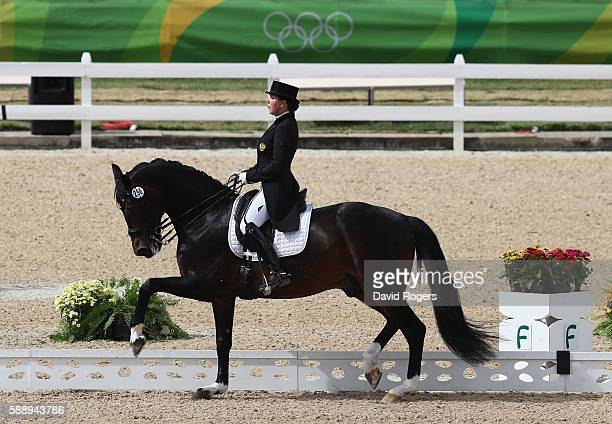 Inessa Merkulova of Russia riding Mister X performs during the final day of the Dressage Grand Prix event on Day 7 of the Rio 2016 Olympic Games held...