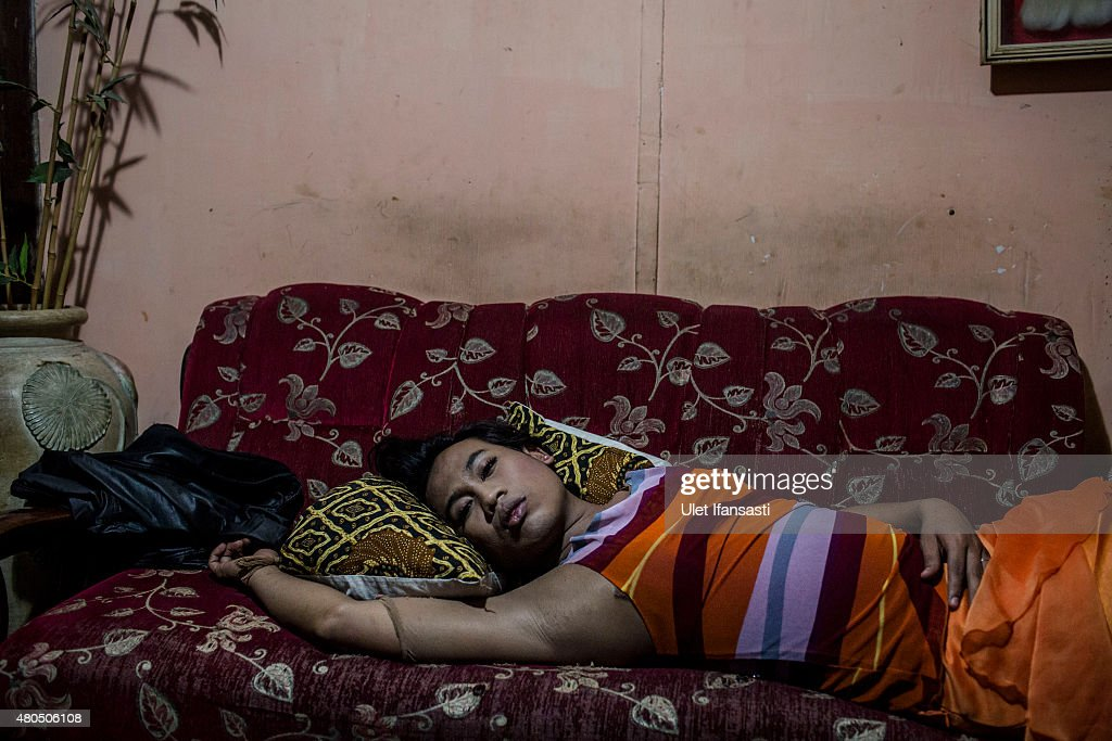 Inez, a member of a Pesantren boarding school, Al-Fatah, for transgender people known as 'waria' take a rest as waiting for break the fast during Ramadan on July 12, 2015 in Yogyakarta, Indonesia. During the holy month of Ramadan the 'waria' community gather to break the fast and pray together. 'Waria' is a term derived from the words 'wanita' (woman) and 'pria' (man). The Koran school Al-Fatah was set back last year's by Shinta Ratri at her house as a place for waria to pray, after their first founder Maryani died. The school operates every Sunday. Islam strictly segregates men from women when praying, leaving no-where for 'the third sex' waria to pray before now.