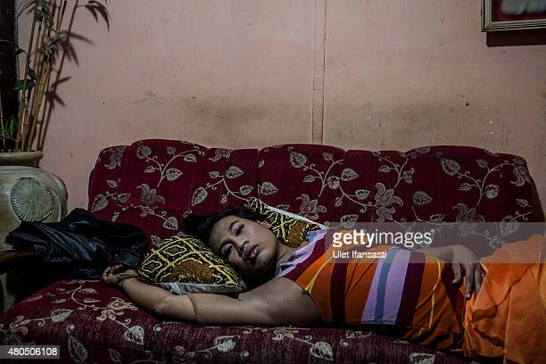 Inez, a member of a Pesantren boarding school, Al-Fatah, for transgender people known as 'waria' take a rest as waiting for break the fast during...