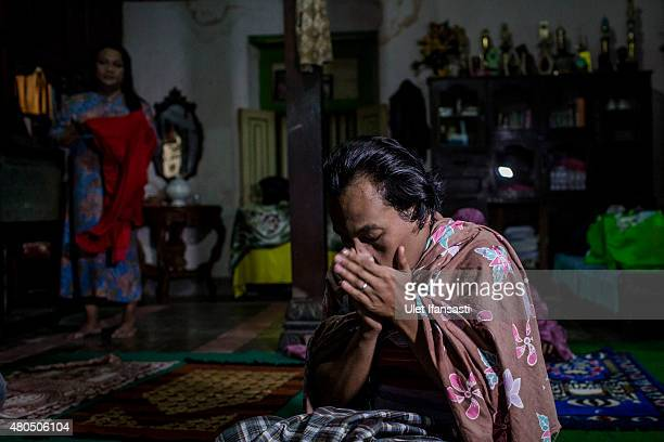 Inez, a member of boarding school for transgenders known as pesatren 'waria', called Al-Fatah, prays during observe ramadan on July 12, 2015 in...