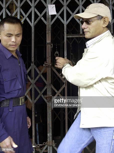 Infamous international criminal Charles Sobhraj leaves Hanuman Dhoka jail to proceed to Kathmandu District Court, 20 October 2003. A Nepal court gave...