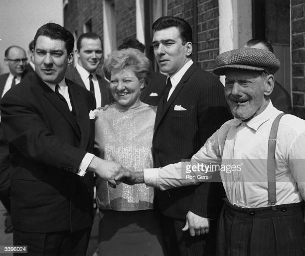 Infamous London gangsters Ronnie and Reggie Kray with their mother Violet and grandfather Jimmy Lee