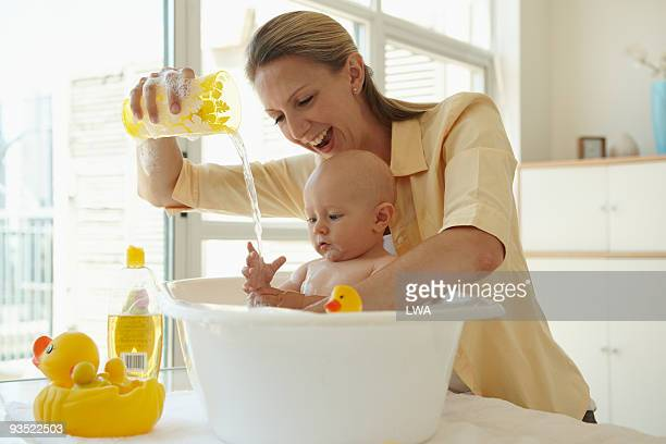 Infant Boy Playing With Water During Bath