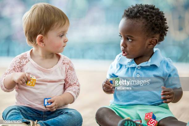 infant friends - nursery school child stock pictures, royalty-free photos & images