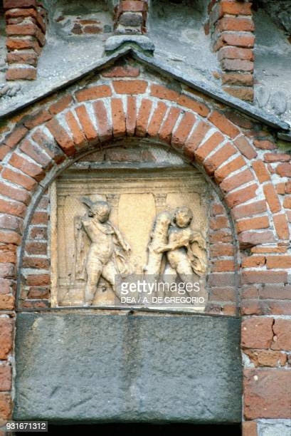 Infant Hercules and Cupid Roman basrelief lunette above the eastern entrance baptistery of Biella Piedmont Italy 2nd century