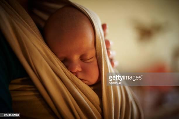 infant in sling